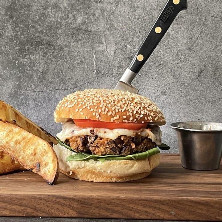 this is a photo of a black bean burger on a sesame seed bun