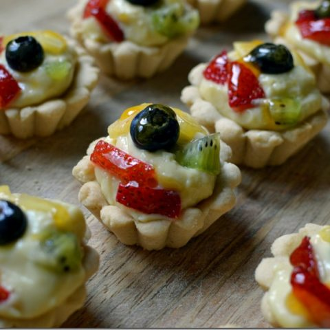this is a photo of mini fruit tarts with apricot glaze
