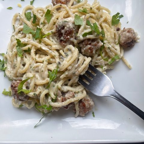 this is a photo of goat cheese pasta with mini meatballs